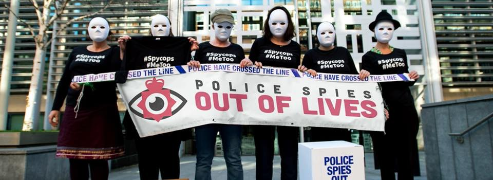 Banner reads Police Spies out of Lives